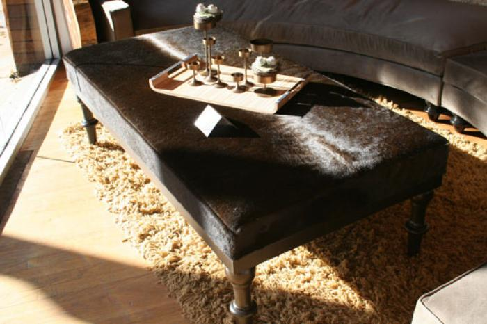Elegant Cowhide Ottoman In Chocolate With Wood Carved Legs